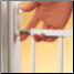 Secure and easy to open and close.  Directional stop keeps it from swinging open over stairs.